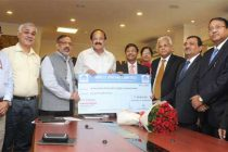 CMD, NBCC, Dr. Anoop Kumar Mittal presenting the dividend cheque for the financial year of 2015-16
