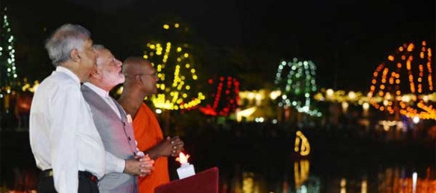 Modi lights up lamps at Sri Lankan temple
