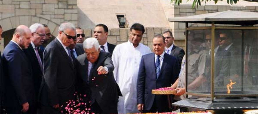 President of the State of Palestine, Mahmoud Abbas paying floral tributes at the Samadhi of Mahatma Gandhi, at Rajghat