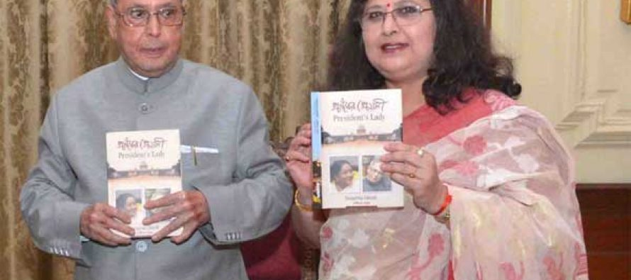 President receives first copy of book on his wife