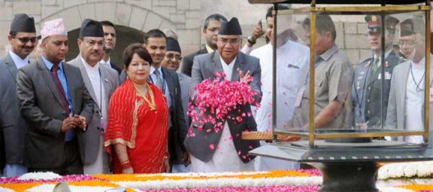 Prime Minister of Nepal, Sher Bahadur Deuba paying floral tributes at the Samadhi of Mahatma Gandhi, at Rajghat, in Delhi