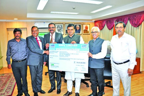 Shri Balraj Joshi, CMD, NHPC Limited handing over dividend payout bank advice for an amount of Rs. 76.43 crore to Shri R. K. Singh, Hon'ble Union Minister of State (Independent Charge) for Power and New & Renewable Energy in the presence of Shri Ajay Kumar Bhalla, Secretary (Power), Govt. of India, Shri Ratish Kumar, Director (Projects), Shri N. K. Jain, Director (Personnel) and Shri D. Chakraborty, General Manager (Finance).