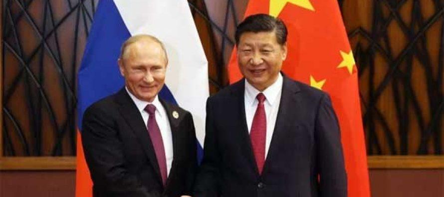 Xi, Putin pledge to enhance regional, international cooperation
