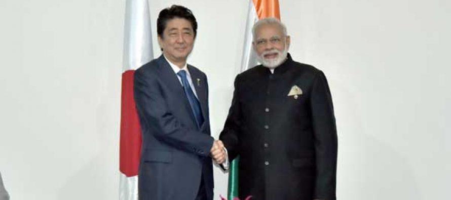 Prime Minister, Narendra Modi meeting the Prime Minister of Japan, Shinzo Abe, in Manila, Philippines