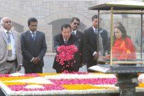 Prime Minister of the Kingdom of Cambodia, Samdech Akka Moha Sena Padei Techo Hun Sen paying floral tributes at the Samadhi of Mahatma Gandhi