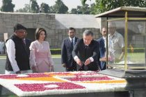 The President of the Republic of Uzbekistan, Shavkat Mirziyoyev paying floral tributes at the Samadhi of Mahatma Gandhi