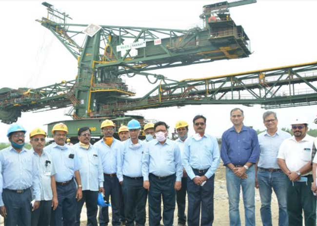 Shri. Prabhakar Chowki, Director (Mines) NLCIL with senior officials and employees of NLCIL just after commissioning the rejuvenated Bucket Wheel Excavator 1420 at the SME Overhaul Yard of Mine-II, Neyveli.